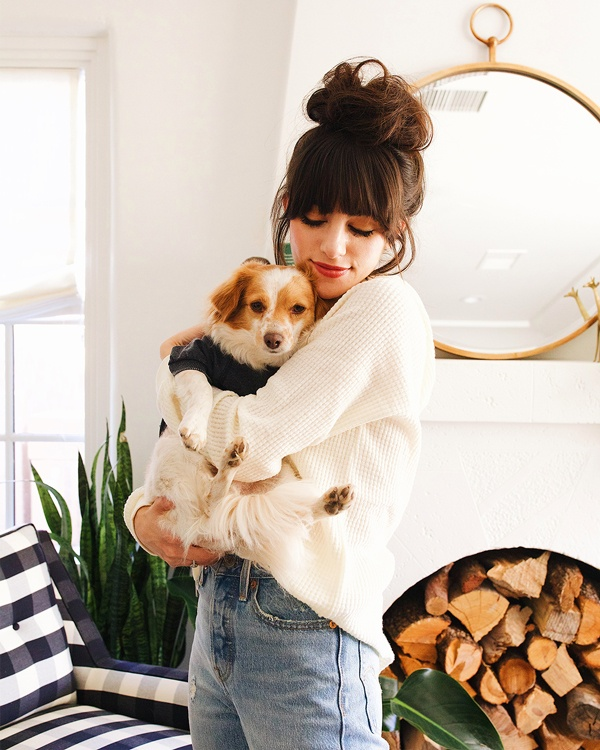 Christina, wearing The Hooded Lace-Up Waffle Thermal by Z SUPPLY in Pearl, holding Henry, in The Burnout Pullover by ZOO SUPPLY in Black