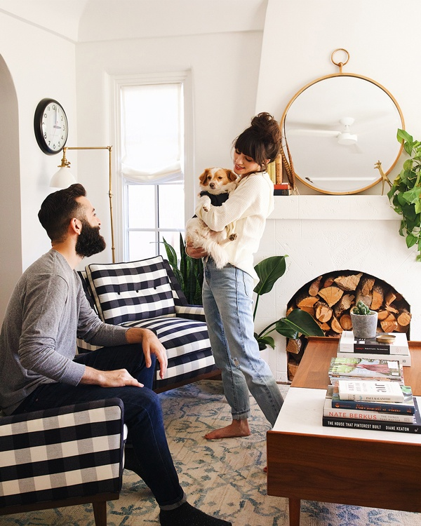 Christina, holding Henry, and Robert in the livingroom wearing Z SUPPLY and ZOO SUPPLY
