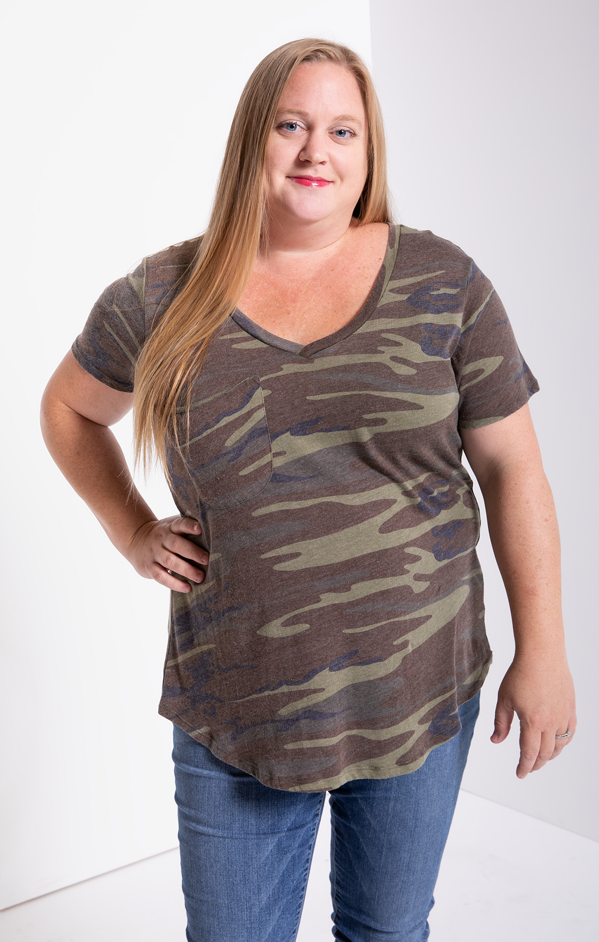 Vanessa wearing The Camo Pocket Tee in camo green, size extra-large